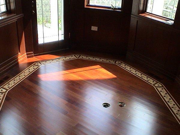 Custom tile wood flooring refinishing trim work marble for Hardwood floors unlimited